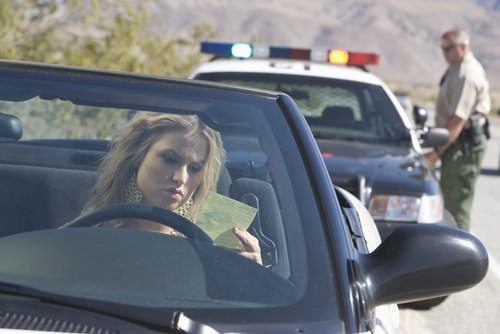girl reading her traffic ticket