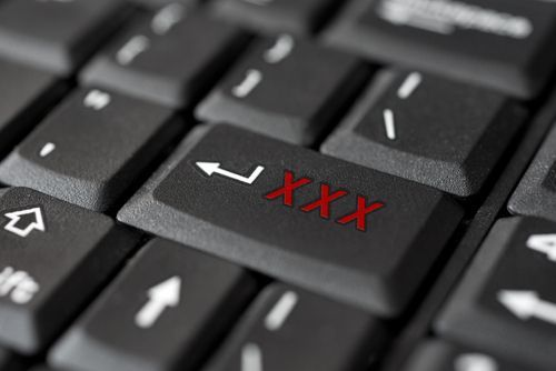 "computer keyboard with a button labeled ""xxx"""