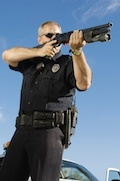 police officer aiming gun