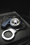 handcuffs, badge, gun