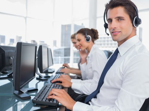 Male receptionist with headset at criminal defense law firm.