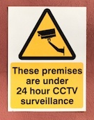 sign that says the premises are under surveillance
