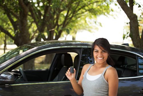 happy teen with car keys - parents may be liable under Vehicle Code 17707 if their child causes an accident