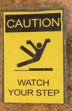 "sign that says ""caution watch your step"""