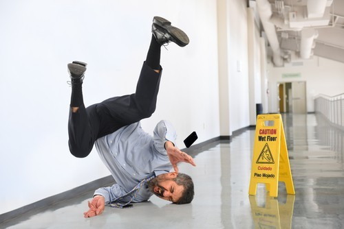 Man slipping on wet floor