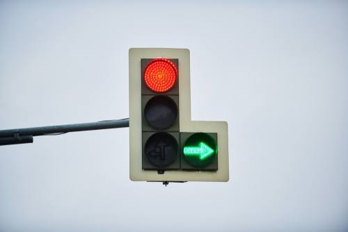 red light and green arrow
