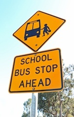 """School Bus Stop Ahead"" sign"