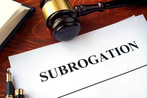 "gavel with ""subrogation"" typed on paper"