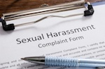 "paper in clipboard that says ""sexual harassment complaint form"""