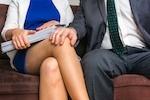 male hand on female knee