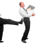 boss kicking fired employee