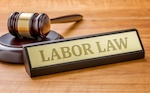"placard that says ""labor law"" with a gavel"