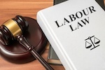 "book with ""labor law"" title and gavel"