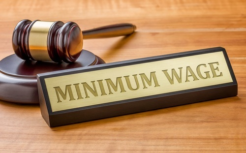 "placard that says ""minimum pay"" and gavel"