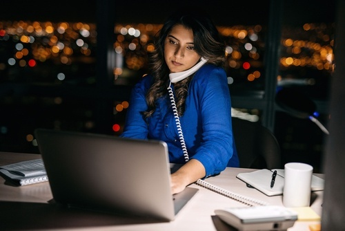 woman working late at desk