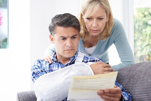 couple looking at medical report california workers' comp
