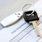 Car-key-on-top-of-insurance-policy-representing-car-insurance