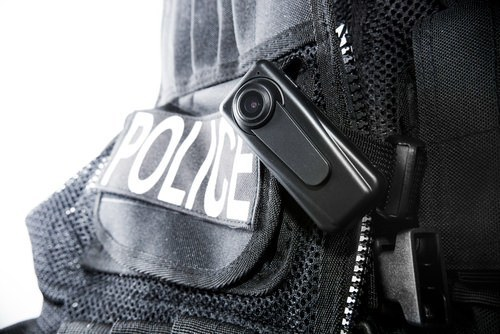 A close-up of a police-body cam. Footage may serve as evidence of the officer's qualified immunity from section 1983 lawsuits.