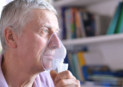 man with a face mask to help breathing