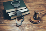 gavel, books, and handcuffs