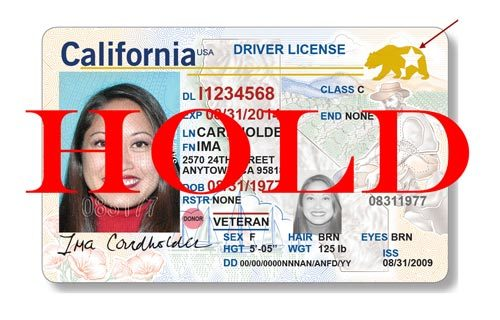 california driver's license with a hold on it