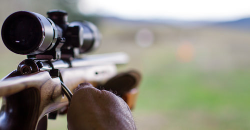 man shooting rifle as an example of what could be a 247 PC violation