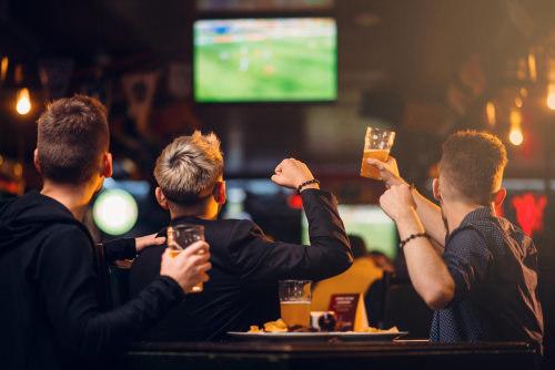 minors drinking beer at bar