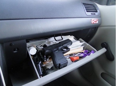 Gun-in-open-glove-compartment