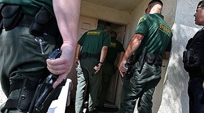 Law-enforcement-officers-entering-home