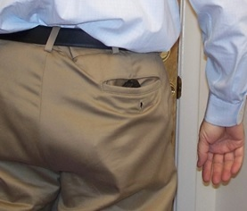 Outline-of-gun-in-man's-khaki-pocket