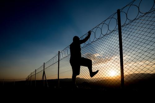 man scaling wall