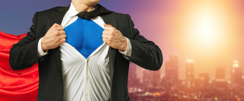 man in suit with superman suit underneath