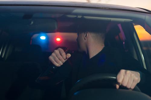 man eluding police car
