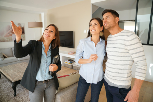 woman showing couple a house