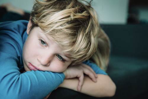 young boy with sad expression