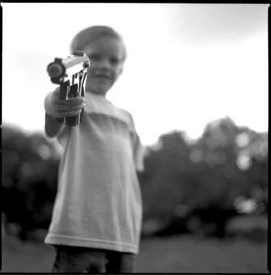 Img-kid-hold-gun