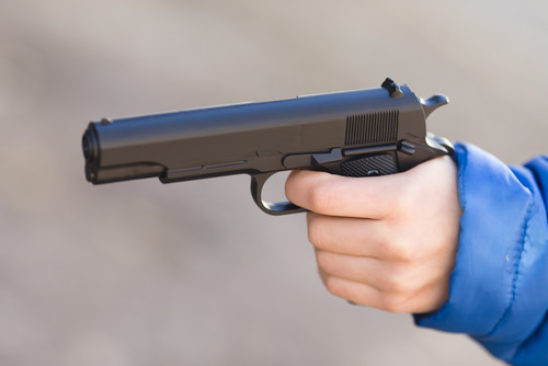 child holding toy gun