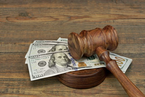 money under gavel representing a fine; failure to appear for a misdemeanor or felony charge is a crime in California