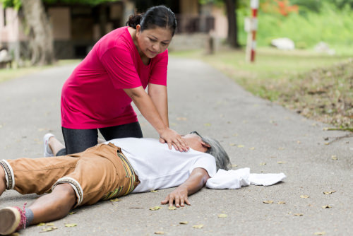 Woman performing CPR as an example of an act that would fall under California's Good Samaritan Law.