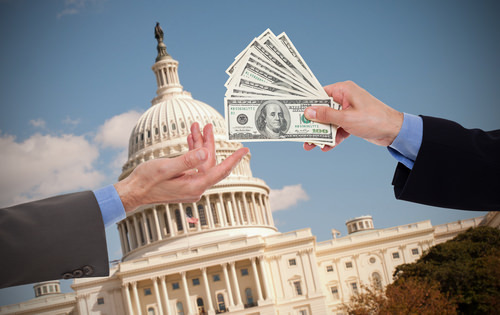 money extortion changing hands in front of government building as an example of extortion in California