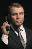suited man with gun