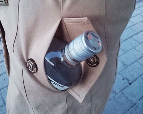 a bottle of vodka in trench coat pocket as ab example of public intoxication in California