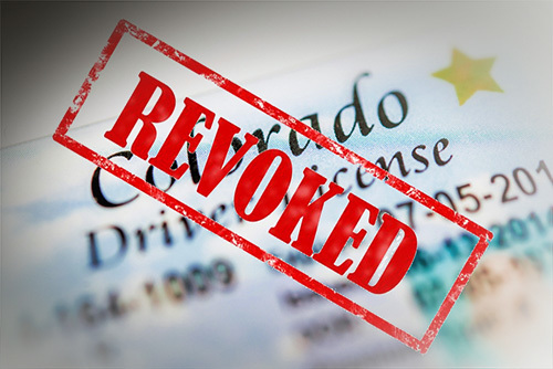 Colorado revoked license, which prohibits the license-holder from driving.