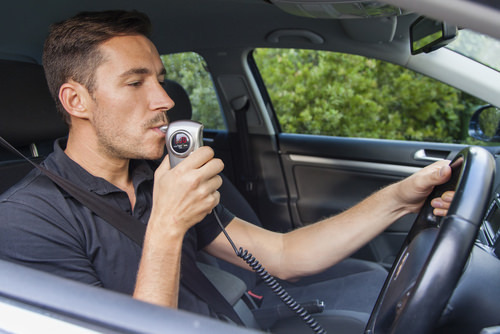 Man using ignition interlock device, which is required after a Nevada DUI conviction per NRS 484C.460