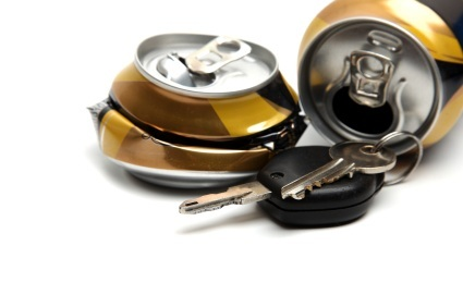 Smashed-beer-cans-beside-car-keys-representing-DUI