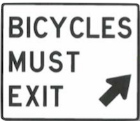 sign that says bikes must exit