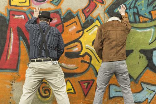 two fellas urinating in public