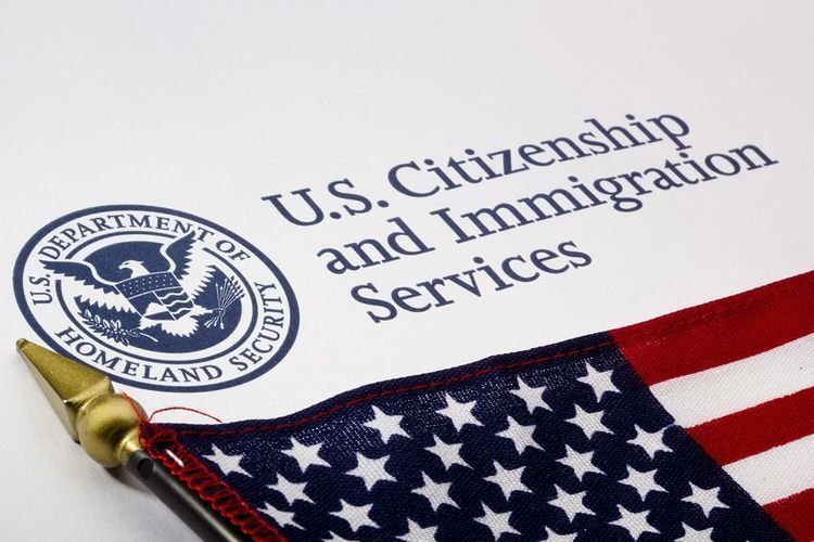 US immigration services emblem. Violating VC 14601.1(a) is not a deportable offense.
