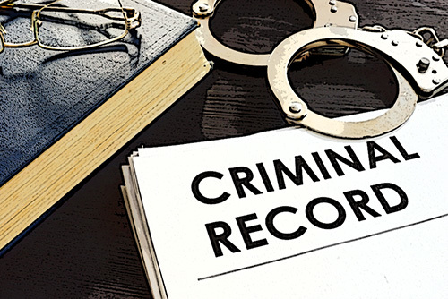 handcuffs and a stack of Texas criminal records - expungement is available in some cases