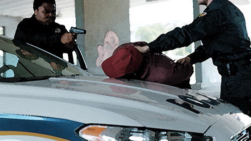 cops arresting suspect